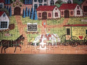 Closeup of a puzzle with a piece handmade by a crew member
